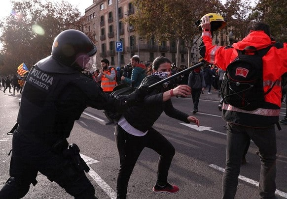 More than 50 people were injured in clashes with police in Barcelona