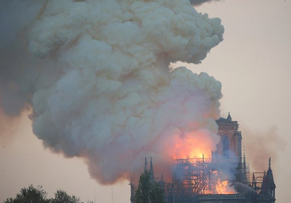 In Paris the Cathedral of Notre-Dame de Paris burns: the spire and roof collapsed