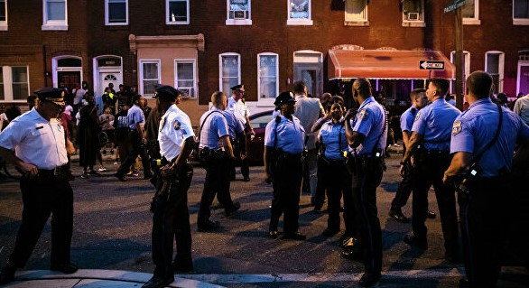In Philadelphia, the building with the shooter brought two police officers