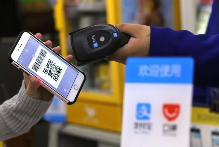Alipay support will likely allow you to pay by QR through Apple Pay